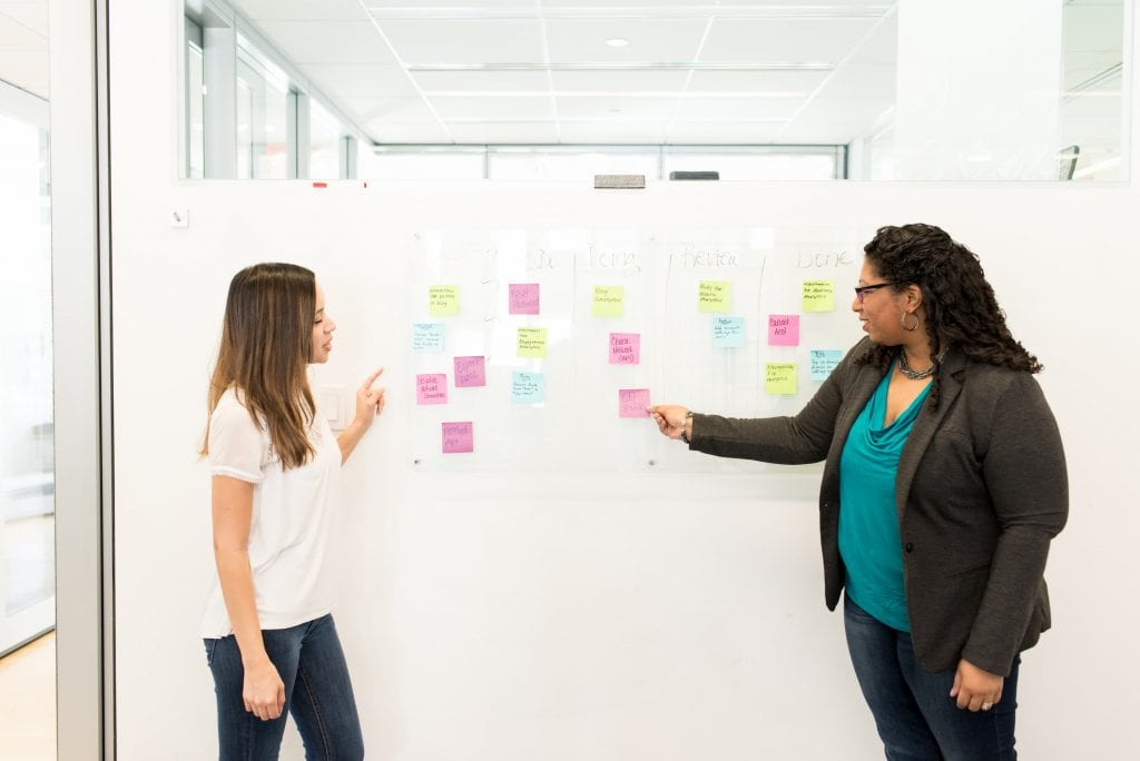 Two women talk during one on one meeting