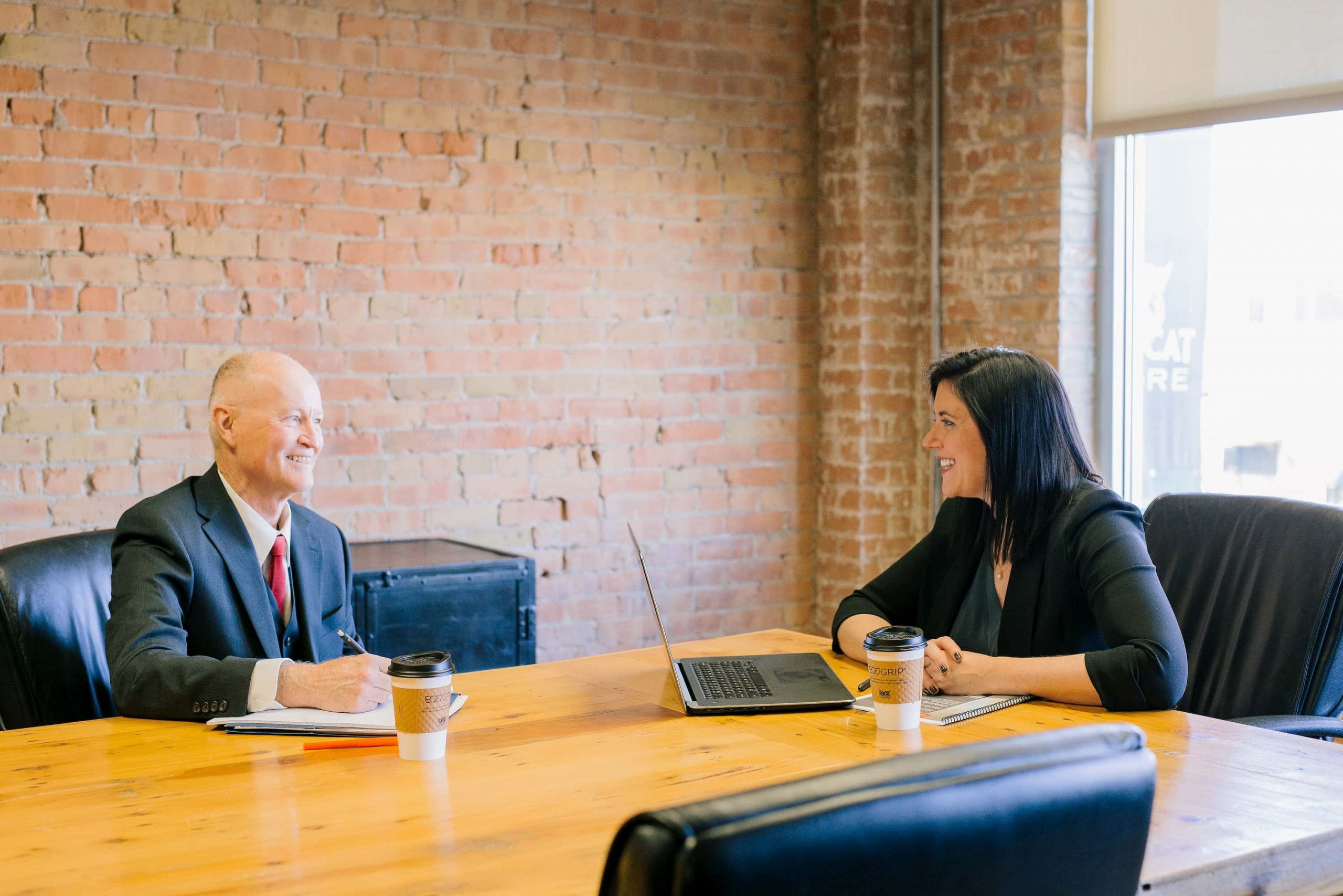 Woman and man holding performance review meeting